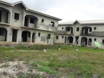 UNCOMPLETED BLOCKS OF BUILDINGS ON AN ACRE OF LAND IN AJAH